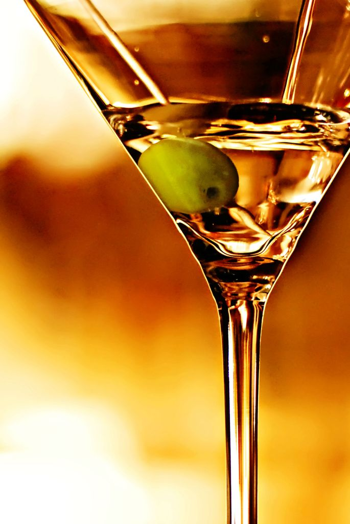 shutterstock_130002590-martini close up with an olive while straining luxe beat magazine web