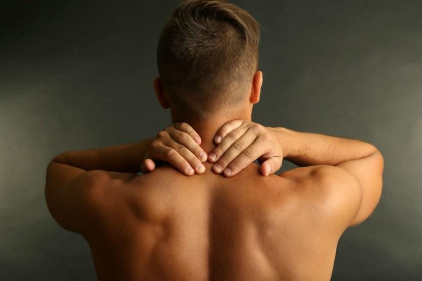 shutterstock_155322758 man neck pain massage luxe beat mag web