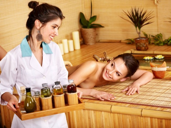 shutterstock_84003463 Young woman getting massage in bamboo spa-web