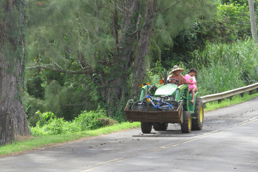 Tractor on road in Hana