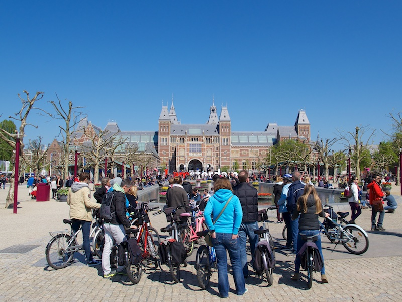 Bicyclists converge in Vondelpark near the Rijksmuseum