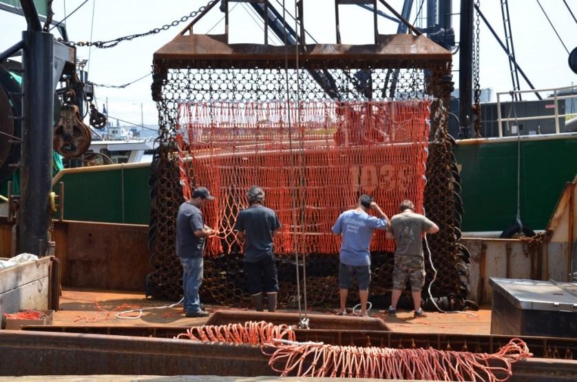 Repairing the fishing nets.