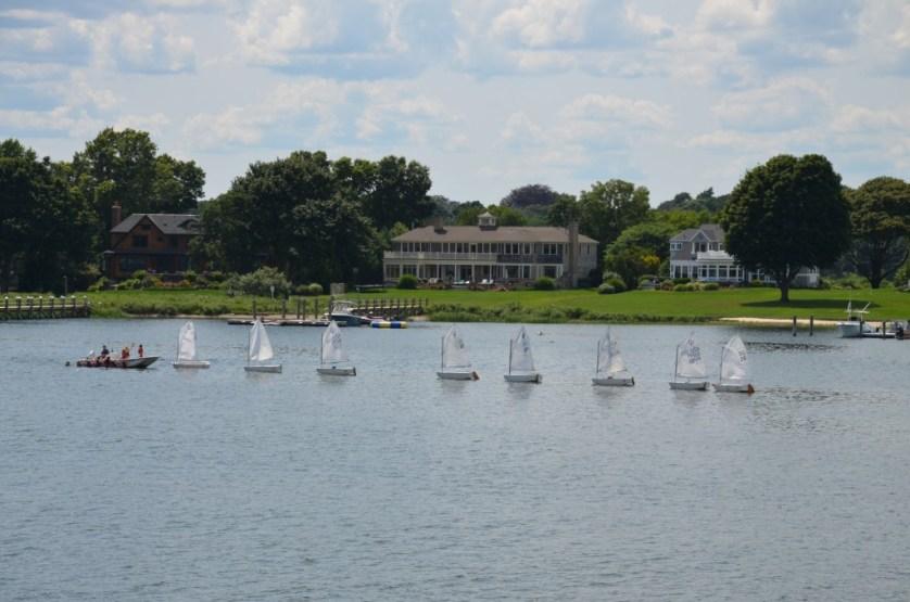 Cruising past a sailboat school.