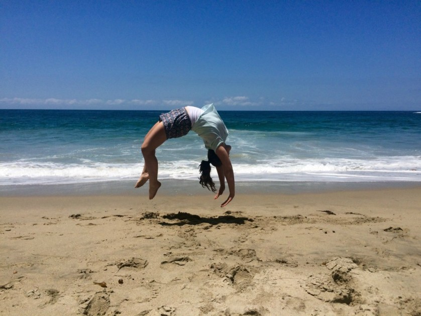 Back handsprings on the beach