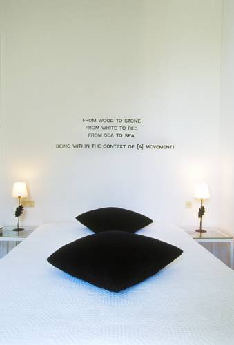 Artist Lawrence Weiner, as represented in our room.