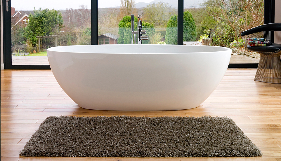 Victoria + Albert Barcelona bath in volcanic limestone is distributed in Quenesland by Luxe by Design, Brisbane.
