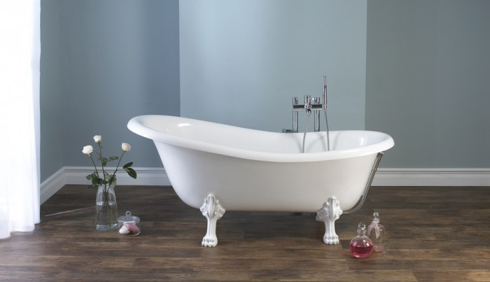 Victoria + Albert Roxburgh traditional bath in volcanic limestone is distributed in Quenesland by Luxe by Design, Australia.