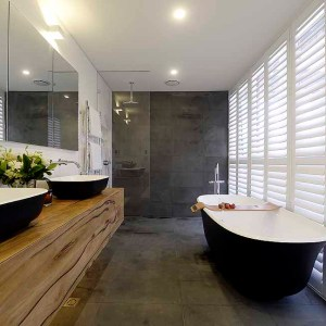 Josh and Charlotte's master ensuite features the Matte Black Amiata bath by Luxe by Design and Victoria + Albert. Buy matte black bath through our stockists today.