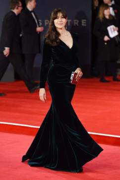 """Actress Monica Bellucci, who played, as she put it in an interview, not a """"Bond girl"""" and """"woman Bond,"""" for the premiere wearing luxurious dark dress with a plunging neckline"""