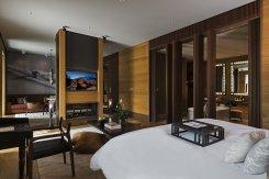 LuxeGetaways_Chedi-Andermatt_Switzerland_Slimming-Wellness-Retreat_Deluxe-Suite-Bedroom_Design_Architecture_Luxury-Suite