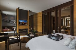 LuxeGetaways_Chedi-Andermatt_Switzerland_Slimming-Wellness-Retreat_Deluxe-Suite-Bedroom_Design_Architecture_Luxury-Suite