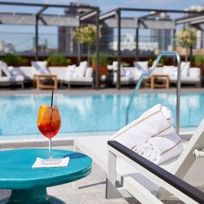 LuxeGetaways - 25 Poolside Experiences - Luxury Hotel Pools - The William Vale - Cocktail at Pool