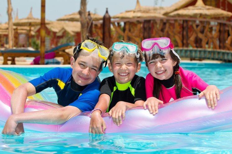 LuxeGetaways - 25 Poolside Experiences - Luxury Hotel Pools - kids in pool