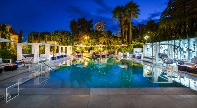 LuxeGetaways - Luxury Travel - Luxury Travel Magazine - Luxe Getaways - Luxury Lifestyle - 18 Nighttime Travel Experiences - Hotel Nighttime Experiences - Odyssey at night - Hotel Metropole at Monte Carlo