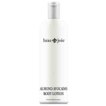almond avocado body lotion on white background