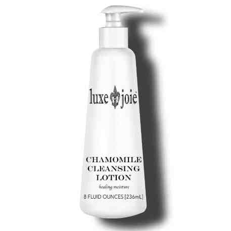 chamomile cleansing lotion on white background