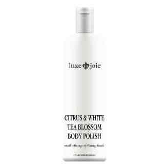 citrus and white tea blossom body polish on white background