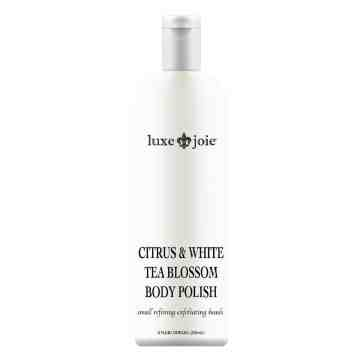citrus and white tea blossom body polish on white background