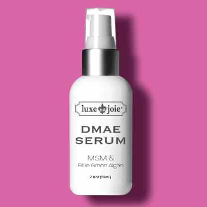 dmae serum on dark pink background