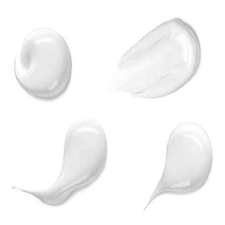 four lotion samples on white background
