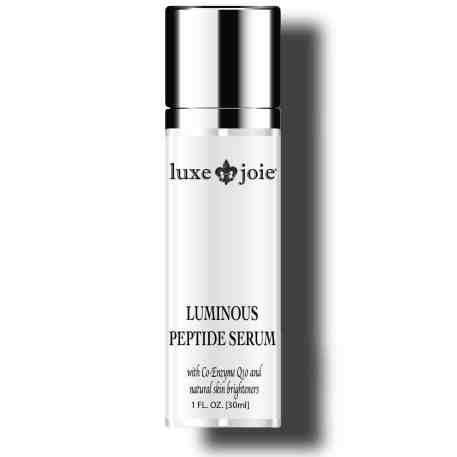 luminous peptide serum on white background