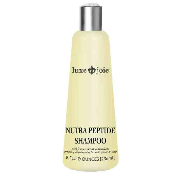 nutra peptide shampoo on white background