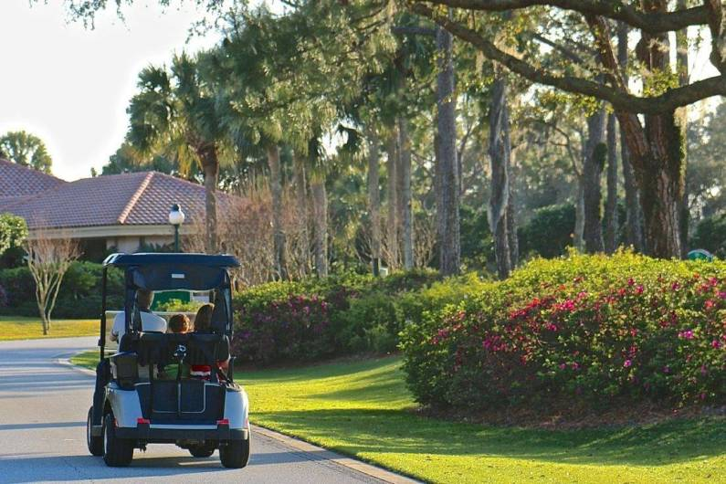 Mellow golf cart rides at the Villas at Grand Cypress