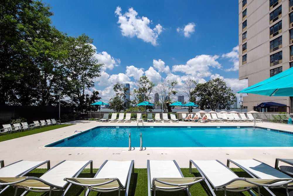 5 NYC Rentals with Outdoor Pools to Beat the August Heat