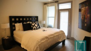 Bedroom at The Monterey by Windsor Apartments in Uptown Dallas TX Lux Locators Dallas Apartment Locators
