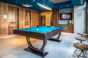 Community Pool Table at The Taylor Apartments in Uptown Dallas TX Lux Locators Dallas Apartment Locators