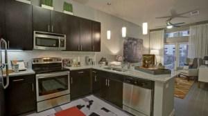 Kitchen Living Room at Moda Victory Park Apartments in Uptown Dallas TX Lux Locators Dallas Apartment Locators