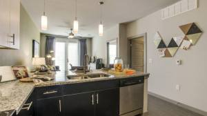 Kitchen Living Room at Routh Street Flats Apartments in Dallas TX Lux Locators Dallas Apartment Locators