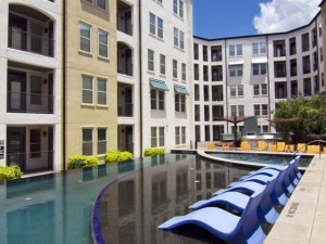 Pool Lounges at The Monterey by Windsor Apartments in Uptown Dallas TX Lux Locators Dallas Apartment Locators