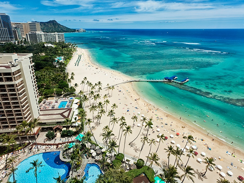 Set against the backdrop of Diamond Head State Monument, Waikiki in Honolulu was once a playground for Hawaiian royalty. Photograph: Getty Images