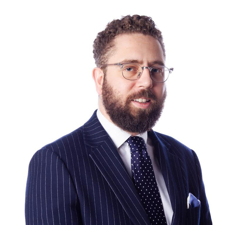 man in suit with a beard