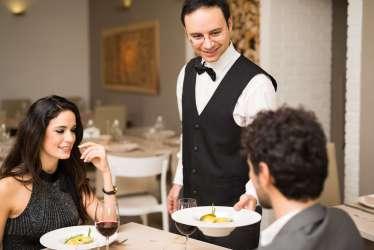 dinner restaurant dining couple michelin london waiter fine food serving having ordering luxury them serviced apartments flight experience awarded establishments