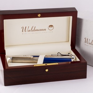 Waldmann John E. Hand & Sons set with blue enamel & sterling silver