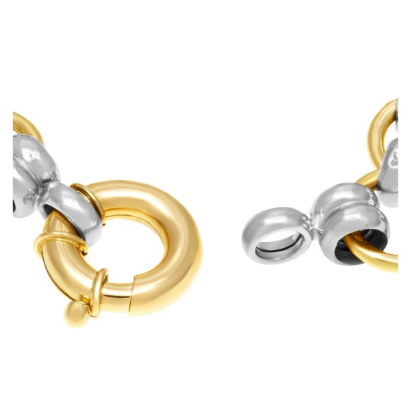 Bracelet in 18k yellow gold and white gold with yellow gold charms