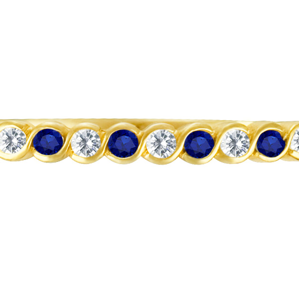 Lovely bangle in 14k with diamonds & blue sapphires