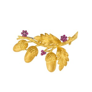 Brooch with ruby flower accents in 18k