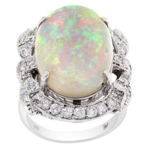 Australian opal & diamond ring in 18k white gold. 1.16 carats in diamonds. Size 7.5
