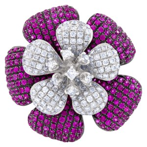 Ladies magnificant ruby and diamond flower ring set in 18k white gold