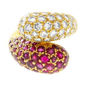 Bypass ruby & diamond ring in 18k yellow gold. 2.5cts in diamonds, 3.00cts rubies. Size 3