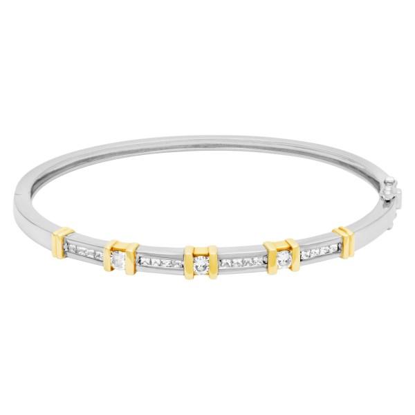 Diamond bangle in 14k white & yellow gold. 0.72 carats in diamonds