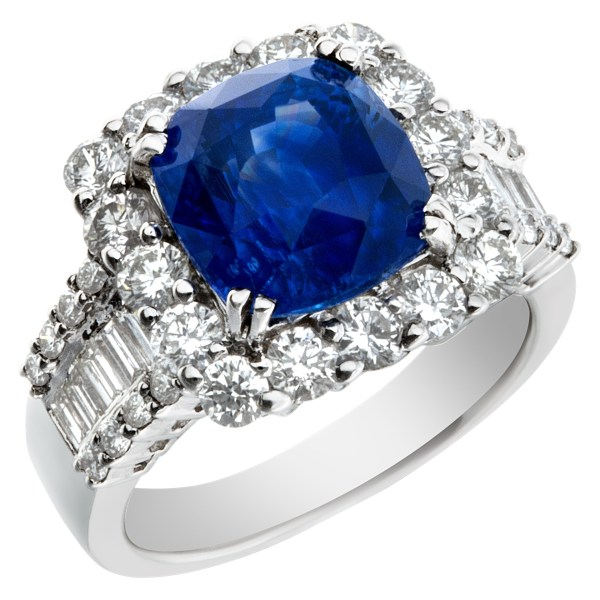 Sparkling 5.73 carat blue sapphire ring with diamond accents in 18k white gold