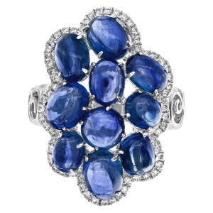 Blue cabachon tanzanite ring with diamond accents in 18k white gold