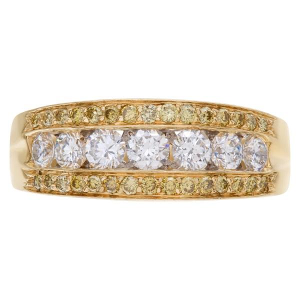 Exquisite Diamond wedding ring with 7 full cut round brilliants diamonds set in 14K yellow gold.