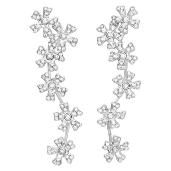 Hanging pave diamond floating flower earrings in 18K white gold.