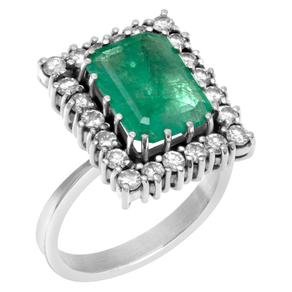 Emerald ring with approximately 4 carat in emerald framed by approximately .66 carats round diamonds in 14k white gold