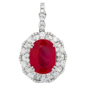 Oval filled ruby pendant (approx 10 carats), set in 18 kt white gold with approx 2 carats full cut r